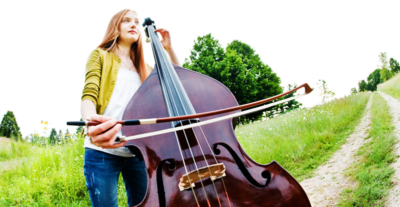 Bass fiddle-playing high school senior. Senior portrait taken outdoors at Matthaei Botanical Gardens.